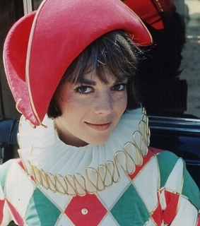actress, harlequin and hat