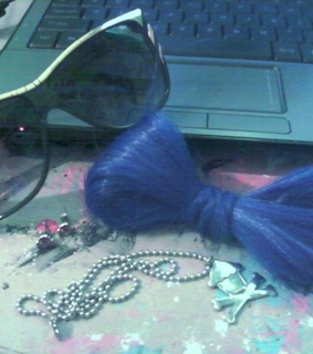 accessories for the day, bow made of hair and cool sunnies