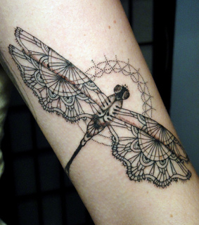 arm, dragonfly and lace