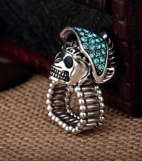 cool, fashion and gold plated skull ring