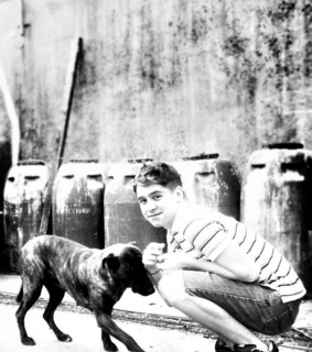 barrels, black and white and boy