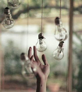 dream, hand and lightbulbs