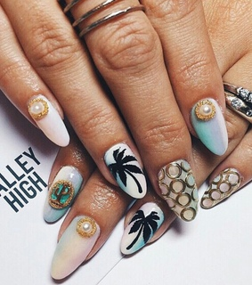 pastel nails, silver rings and claw nails
