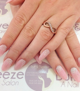 gold rings, claw nails and light pink nails
