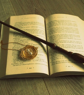 book, clock and gryffindor