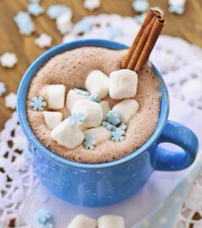 marshmellows, hot chocolate and blue cup