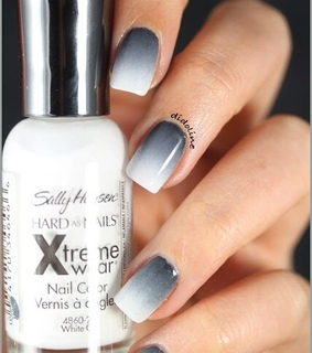 shades of grey, white and nails