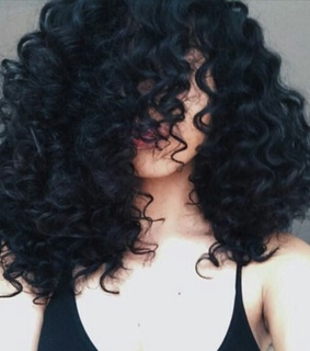 black, curly hair and light skinned