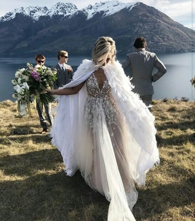 feather, flowers and beach wedding
