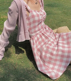 grass, pink cardigan and pink