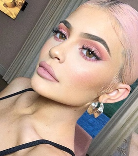 pink makeup, dyed hair and pink lips