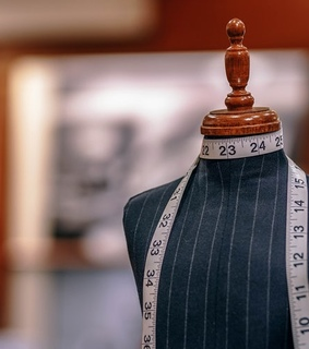 mannequin, measuring tape and tailor