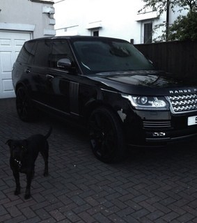 black, expensive and range rover