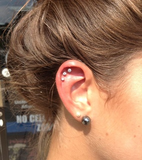 three piercings, cartilage and ear