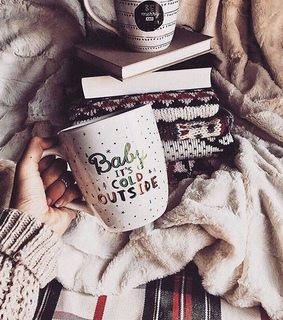 book, baby its cold outside and mug