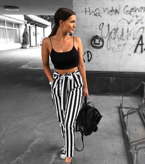 striped pants, black top and backpack