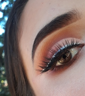 glitter, orange look and brows