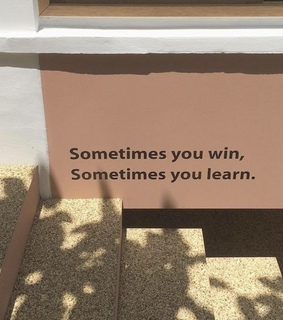 win, quote and building