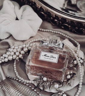 pearls, hair accessories and perfume