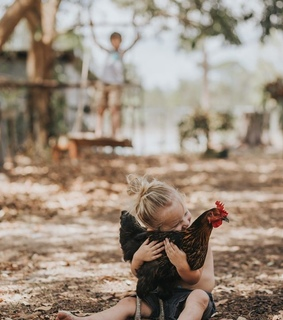 girl, baby and farm