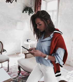 necklace, striped shirt and white jeans