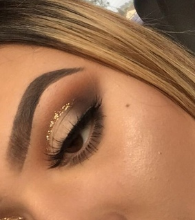 brows, gold and eye makeup