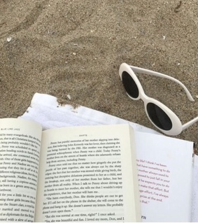 Paper, beach and book