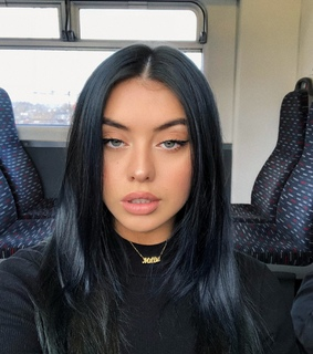 black hair, middle part and beauty