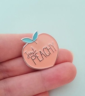 peach, fruit and brooch
