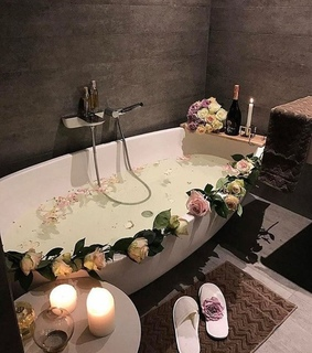 bathroom, candlelight and flowers