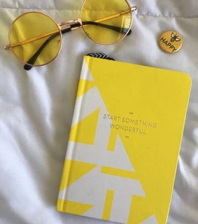 book, yellow and sunglasses