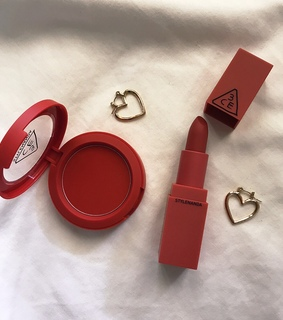 red, jewerly and makeup