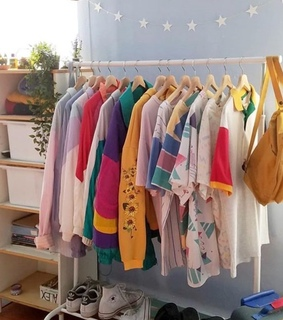 room, backpack and clothes rack