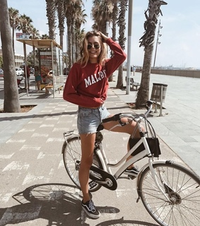bicycle, red shirt and sea