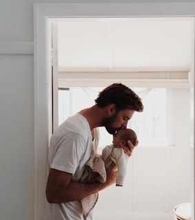 dad, baby and new born