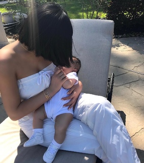 white outfit, mom and baby