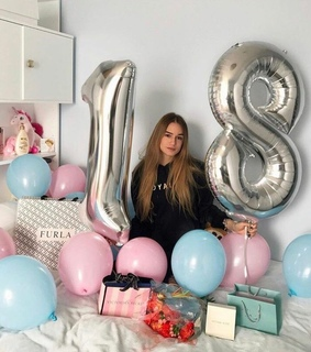 birthday girl, balloons and surprise