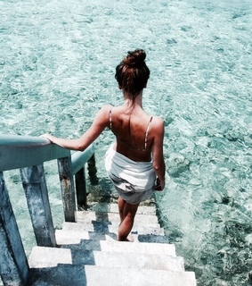 sparkling waters, beach and girl