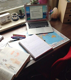 pencils, laptop and writing