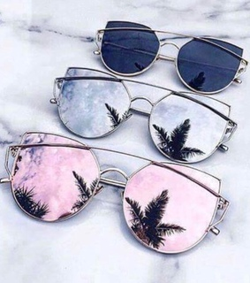 marble background, sunglasses and palm trees
