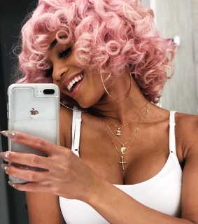 pink hair, curly hair and white teeth