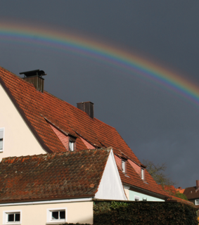 Houses, rainbow and spring