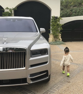 baby stormi, kylie jenner and luxury car