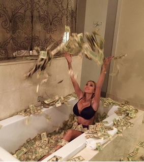 bathing in money, moneybath and banknotes