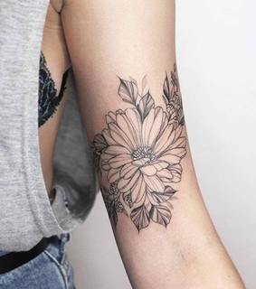 arms, flowers and ink