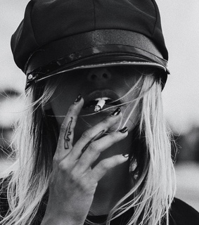 black and white, blonde hair and cap