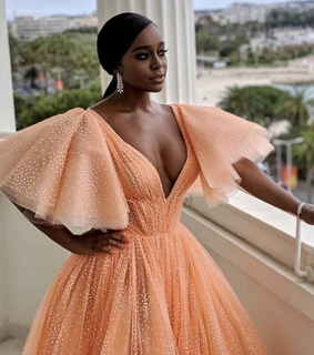 aja naomy king, orange dress and mocha cafe skin