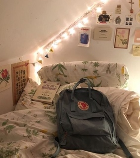 bed, lights and fjallraven kanken