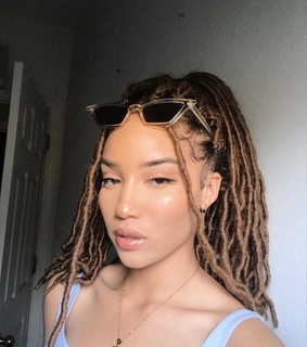 clear skin, braids and sunglasses