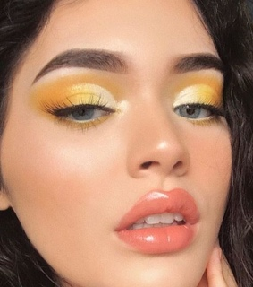 blue eyes, shimmery yellow eyeshadow and icon